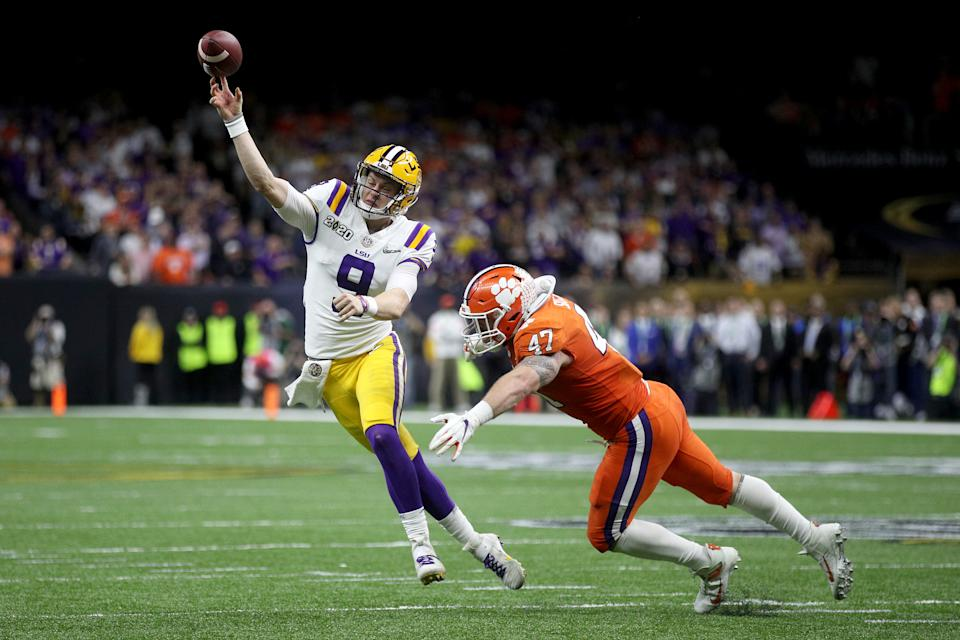 NEW ORLEANS, LOUISIANA - JANUARY 13: Joe Burrow #9 of the LSU Tigers throws the ball under pressure as James Skalski #47 of the Clemson Tigers tries to defend during the College Football Playoff National Championship game at Mercedes Benz Superdome on January 13, 2020 in New Orleans, Louisiana. (Photo by Chris Graythen/Getty Images)