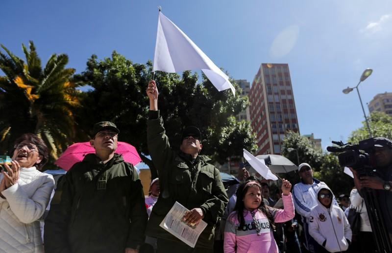 Bolivian people and police officers participate in a Mass offered in intention of peace in the country, in La Paz