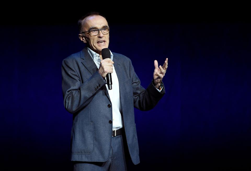 """Danny Boyle, director of the upcoming film """"Yesterday,"""" speaks during the Universal Pictures presentation at CinemaCon 2019, the official convention of the National Association of Theatre Owners (NATO) at Caesars Palace, Wednesday, April 3, 2019, in Las Vegas. (Photo by Chris Pizzello/Invision/AP)"""