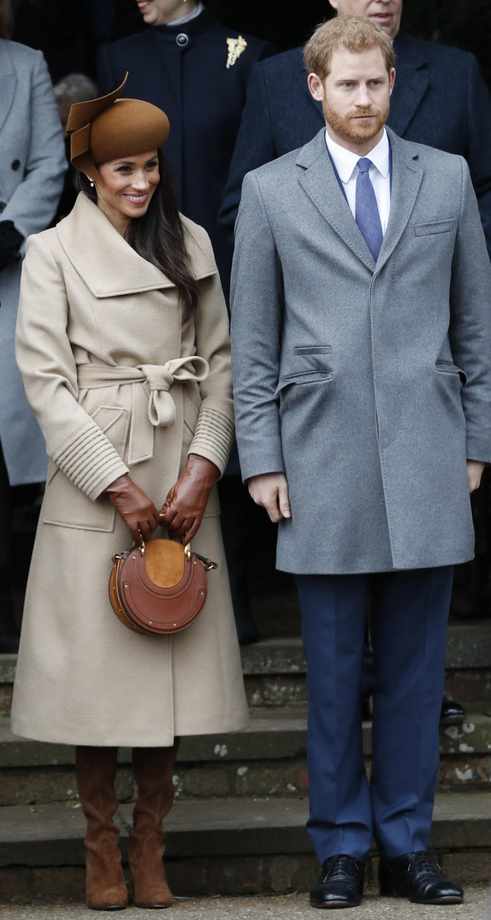 <p>For her first Christmas Day church service with the royals, Meghan chose a £986 camel coat by Canadian brand Sentaler paired with a a £900 circle bag by Chloe and £630 brown suede Stuart Weitzman boots. Her stand-out hat is thought to be by royal milliner Jane Taylor. <i>[Photo: Getty]</i> </p>
