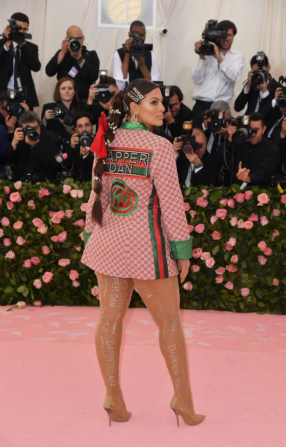The model's look was much more low-key than her counterparts but she still stunned with a waist-length ponytail and a a checkered tuxedo dress. Photo: Getty Images