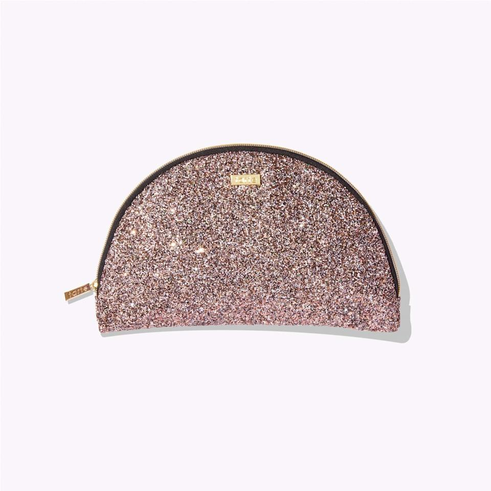 "Everyone needs a bedazzled makeup case, right? This half-moon one is particularly cute. P.S.: There are <a href=""https://www.pjtra.com/t/TUJGRU5ISUJGTktJTUVCRklFTUZN?sid=tartecosmeticssale&url=https%3A%2F%2Ftartecosmetics.com%2Fen_US%2Fbeauty-kit%2Fcustom-beauty-kit%2F1200.html%23beauty-kit-bag%3D846733042968"" rel=""nofollow"" target=""_blank"">three more to choose from</a>. $15, Tarte. <a href=""https://www.pntrs.com/t/TUJGRU5ISUJGTktJTUVCRklFTUZN?sid=tartecosmeticssale&url=https%3A%2F%2Ftartecosmetics.com%2Fen_US%2Fkit-bag%2Fglitter-half-moon-bag%2F846733042944.html%3Fcgid%3Dbeauty-kit-bag"">Get it now!</a>"