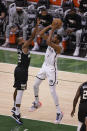Brooklyn Nets' Kevin Durant shoots against Milwaukee Bucks forward Khris Middleton (22) during the first half of Game 6 of a second-round NBA basketball playoff series Thursday, June 17, 2021, in Milwaukee. (AP Photo/Jeffrey Phelps)