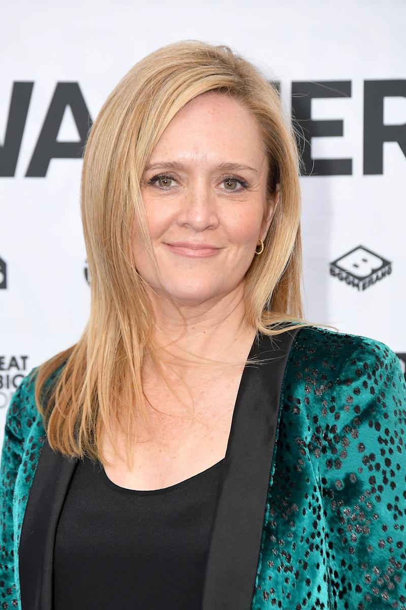 Samantha Bee looks glossy in green suit with black poaches.