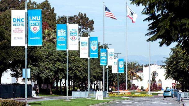 PHOTO: Signage for the sixth Democratic presidential candidates' debate on, co-sponsored by PBS NewsHour and POLITICO and held at Loyola Marymount University's Gersten Pavilion, is seen posted on the campus, Dec. 11, 2019. (Brian Cahn/Zuma Press)