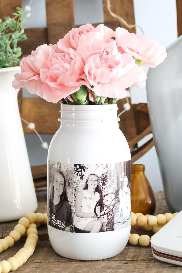 """<p>For a centerpiece that double as a photo display, make this sophisticated photo mason jar, which you can then fill with flowers. </p><p><strong><em><a href=""""https://www.thecountrychiccottage.net/diy-photo-mason-jar/"""" rel=""""nofollow noopener"""" target=""""_blank"""" data-ylk=""""slk:Get the tutorial at The Country Chic Cottage"""" class=""""link rapid-noclick-resp"""">Get the tutorial at The Country Chic Cottage</a>. </em></strong></p><p><a class=""""link rapid-noclick-resp"""" href=""""https://www.amazon.com/Ball-Smooth-Sided-Mason-Regular-Ounces/dp/B07H2GQWZ6?tag=syn-yahoo-20&ascsubtag=%5Bartid%7C10070.g.37055923%5Bsrc%7Cyahoo-us"""" rel=""""nofollow noopener"""" target=""""_blank"""" data-ylk=""""slk:SHOP MASON JAR"""">SHOP MASON JAR</a></p>"""
