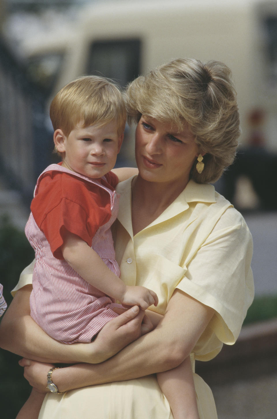 Diana, Princess of Wales (1961 - 1997) with her son Prince Harry during a holiday with the Spanish royal family at the Marivent Palace in Palma de Mallorca, Spain, August 1987. (Photo by Terry Fincher/Princess Diana Archive/Getty Images)