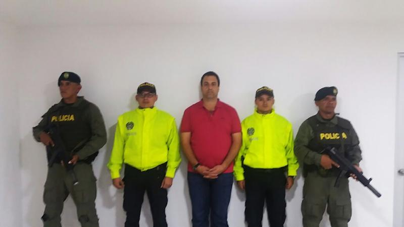 Handout video grab released the Police of Colombia showing Panamanian Nidal Ahmed Waked Hatum (R) after he was arrested in Bogota on May 4, 2016 (AFP Photo/Policia De Colombia)
