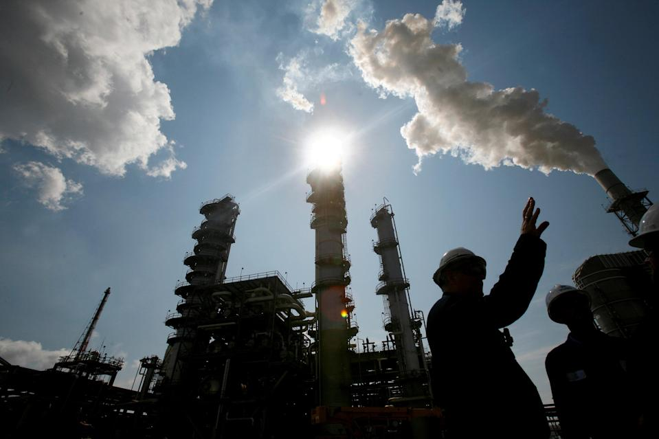 FILE PHOTO: James Prokupek (L), an engineering department process design manager for the Valero St. Charles Oil Refiner, is seen in silhouette during a tour of the refinery in Norco, Louisiana, August 15, 2008. REUTERS/Shannon Stapleton/File Photo