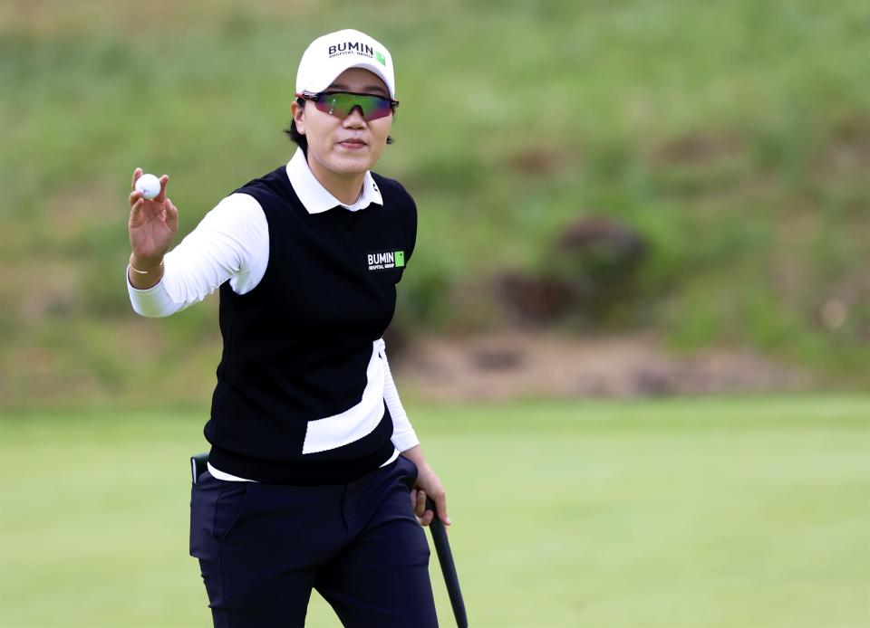 Jeongeun Lee, of South Korea, waves to the crowd after putting out on the 18th green during the final round of the LPGA Cambia Portland Classic golf tournament in West Linn, Ore., Sunday, Sept. 19, 2021. (AP Photo/Steve Dipaola)