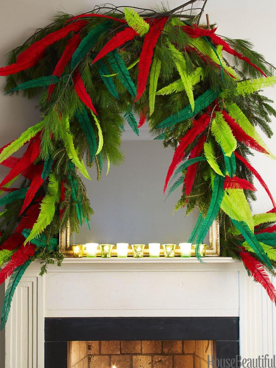 "<p>Outline a simple mirror in <a href=""https://www.housebeautiful.com/room-decorating/colors/tips/g492/red-and-green-christmas-decorations/"" rel=""nofollow noopener"" target=""_blank"" data-ylk=""slk:Christmas greenery"" class=""link rapid-noclick-resp"">Christmas greenery</a>, then stick in feathers. It's unexpected, but totally statement-making. </p>"