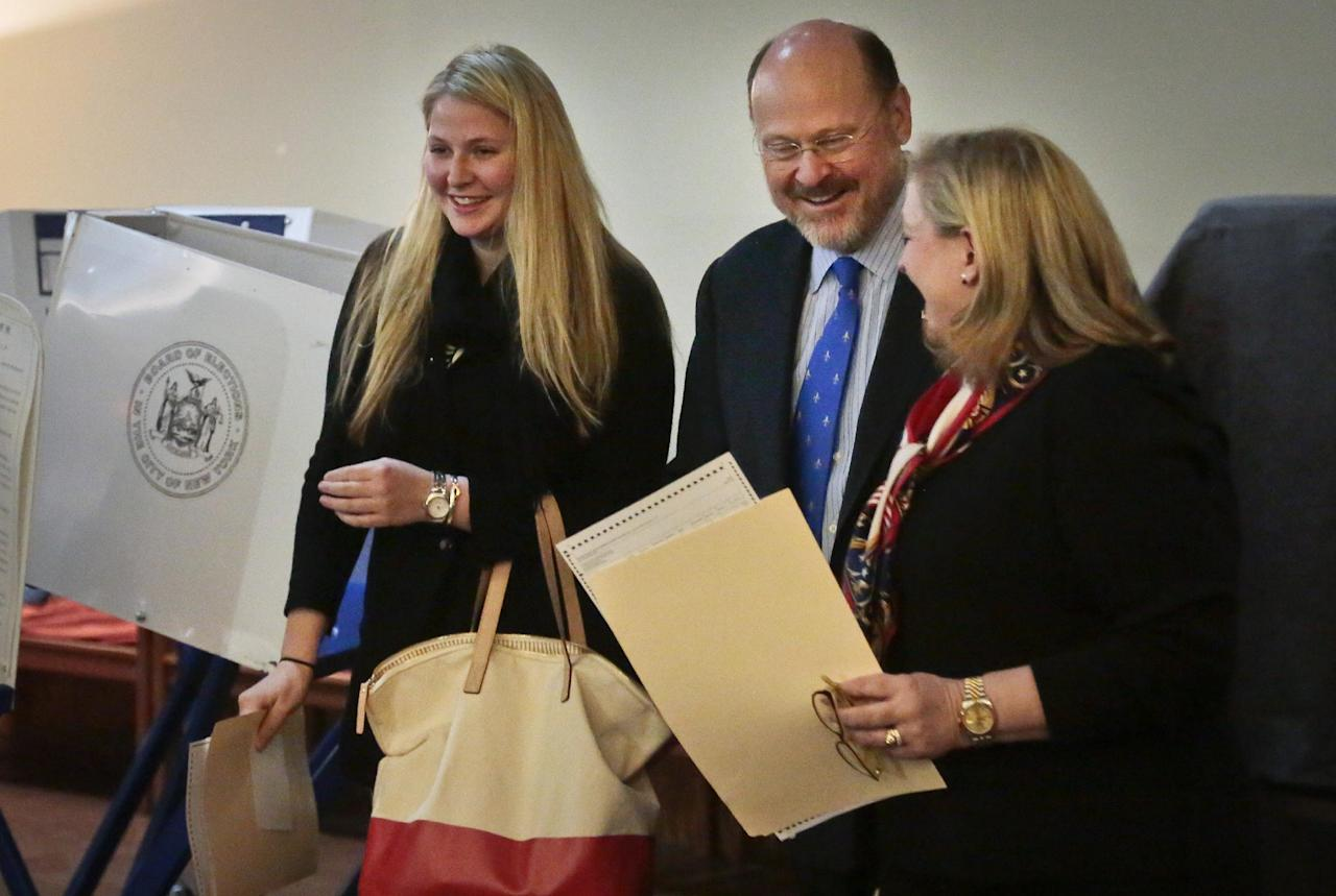 Republican mayoral candidate Joe Lhota, center, his wife Tamra, right, and daughter Kathryn, share a moment of laughter after voting in the general election on Tuesday, Nov. 5, 2013, in the Brooklyn borough of New York. Lhota is running against Democrat candidate Bill de Blasio. (AP Photo/Bebeto Matthews)