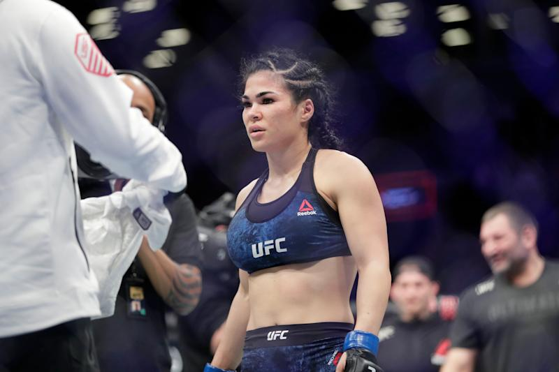 Rachael Ostovich reacts after losing a women's flyweight mixed martial arts bout against Paige Vanzant at UFC Fight Night Saturday, Jan. 19, 2019, in New York. Vanzant stopped Ostovich in the second round. (AP Photo/Frank Franklin II)