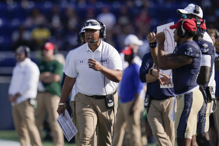 Navy head coach Ken Niumatalolo looks on during the first half of an NCAA college football game against UCF, Saturday, Oct. 2, 2021, in Annapolis, Md. (AP Photo/Julio Cortez)