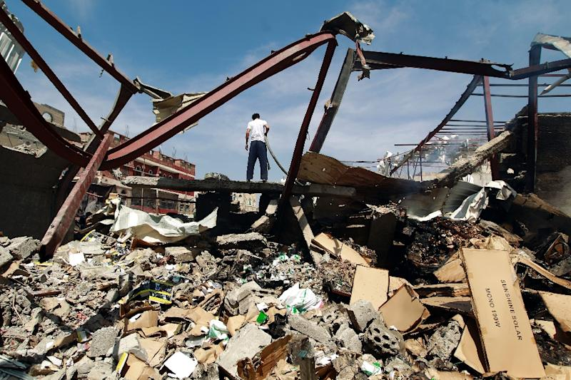 A Yemeni man stands amid the rubble of a food storage warehouse after it was targeted by air strikes carried out by the Saudi-led coalition in the capital Sanaa on October 26, 2015 (AFP Photo/Mohammed Huwais)