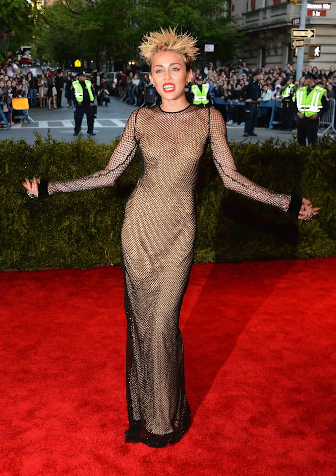 <p>Never one to shy away from controversy, Miley Cyrus caused a stir when she rocked up at the 2013 Met Gala in this punk-rocker style sheath by Marc Jacobs. Photo: Getty Images </p>