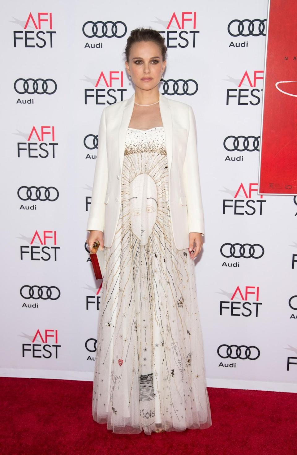 <p>Pairing a printed Dior dress with a classic crisp white blazer, the star looked every inch the film star at the premiere of her movie 'Jackie'. [Photo: Getty] </p>
