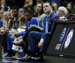 Kentucky head coach Matthew Mitchell, front right, watches the action in the second half of an NCAA college basketball game against Mississippi State at the women's Southeastern Conference tournament Friday, March 2, 2018, in Nashville, Tenn. Mississippi State won 81-58. (AP Photo/Mark Humphrey)