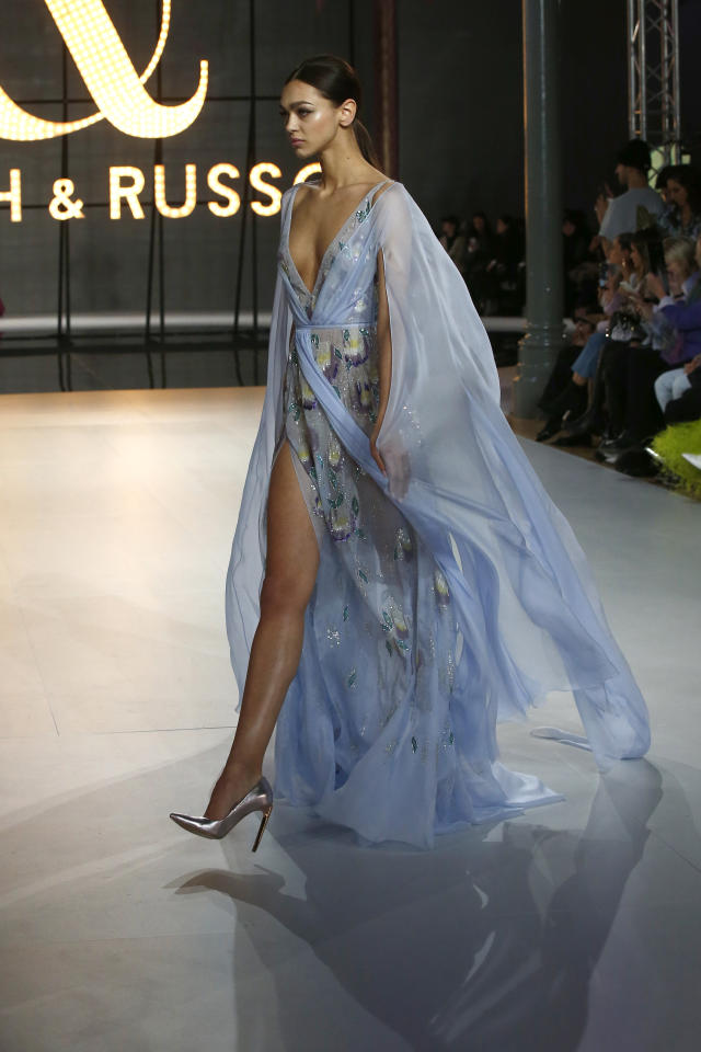 A model wears a creation for the Ralph & Russo Spring/Summer 2019 Haute Couture fashion collection presented in Paris, Monday Jan. 21, 2019. (AP Photo/Michel Euler)
