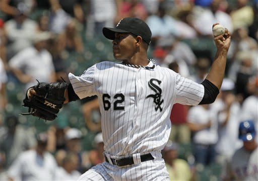 Chicago White Sox starter Jose Quintana throws against the Texas Rangers during the first inning of a baseball game in Chicago, Thursday, July 5, 2012. (AP Photo/Nam Y. Huh)