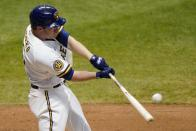 Milwaukee Brewers' Jedd Gyorko hits a two-run home run during the eighth inning of a baseball game against the Minnesota Twins Tuesday, Aug. 11, 2020, in Milwaukee. (AP Photo/Morry Gash)