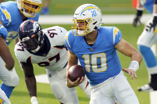 Los Angeles Chargers quarterback Justin Herbert (10) runs against the Denver Broncos during the first half of an NFL football game Sunday, Dec. 27, 2020, in Inglewood, Calif. (AP Photo/Ashley Landis)