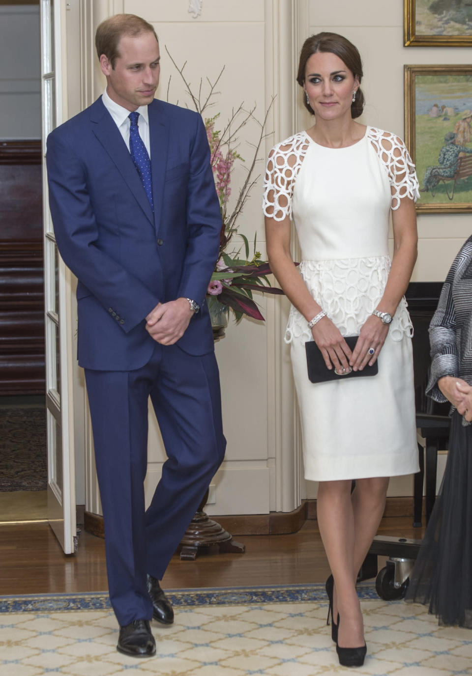 <p>For a reception in Australia, Kate donned a chic white dress by Lela Rose. Jimmy Choo heels and a Mulberry clutch topped off her outfit. </p><p><i>[Photo: PA]</i></p>
