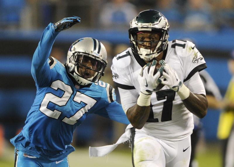 Philadelphia Eagles' Alshon Jeffery (17) catches a pass in front of Carolina Panthers' Kevon Seymour (27) in the second half of an NFL football game in Charlotte, N.C., Thursday, Oct. 12, 2017. (AP Photo/Mike McCarn)