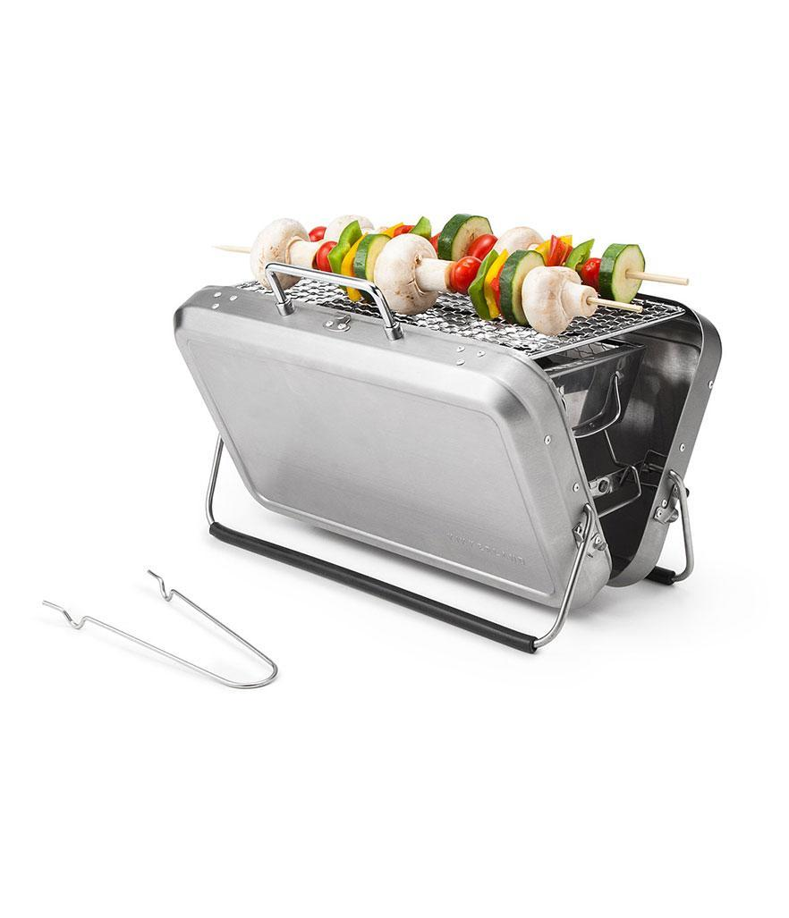 """<p>Uncommon Goods Portable Briefcase BBQ Grill, $80, <a href=""""http://www.uncommongoods.com/product/portable-briefcase-bbq-grill"""" rel=""""nofollow noopener"""" target=""""_blank"""" data-ylk=""""slk:uncommongoods.com"""" class=""""link rapid-noclick-resp"""">uncommongoods.com</a></p>"""