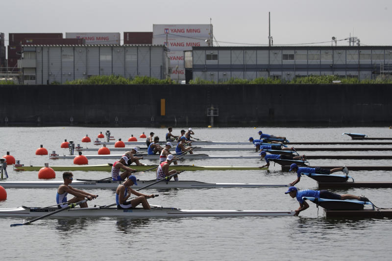 Rowers get ready for a race during the 2019 World Rowing Junior Championships at the Sea Forest Waterway, a venue for rowing and canoeing events at the Tokyo 2020 Olympics, Saturday, Aug. 10, 2019, in Tokyo. (AP Photo/Jae C. Hong)