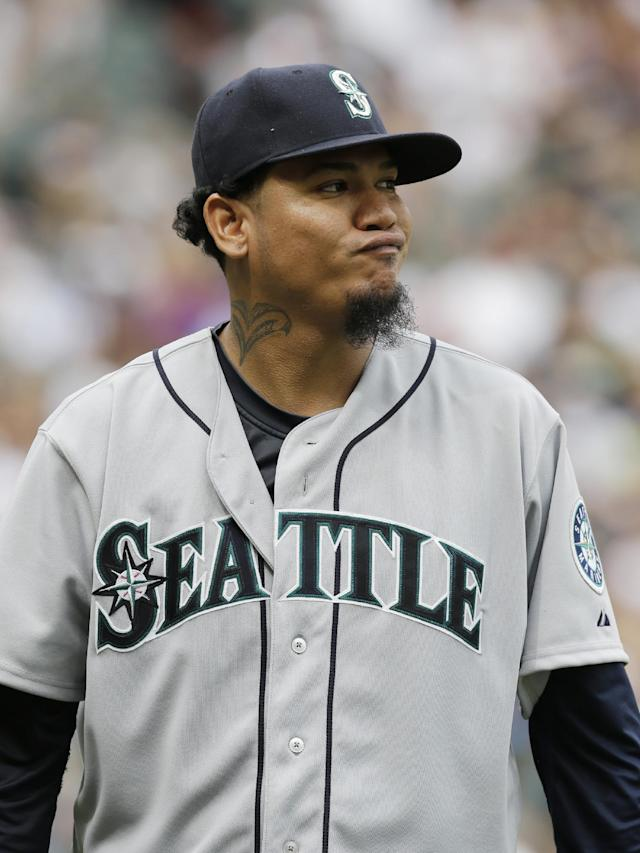 Seattle Mariners starter Felix Hernandez reacts as he walks back to the dugout during the eighth inning of a baseball game against the Chicago White Sox Seattle Mariners in Chicago on Saturday, July 5, 2014. (AP Photo/Nam Y. Huh)