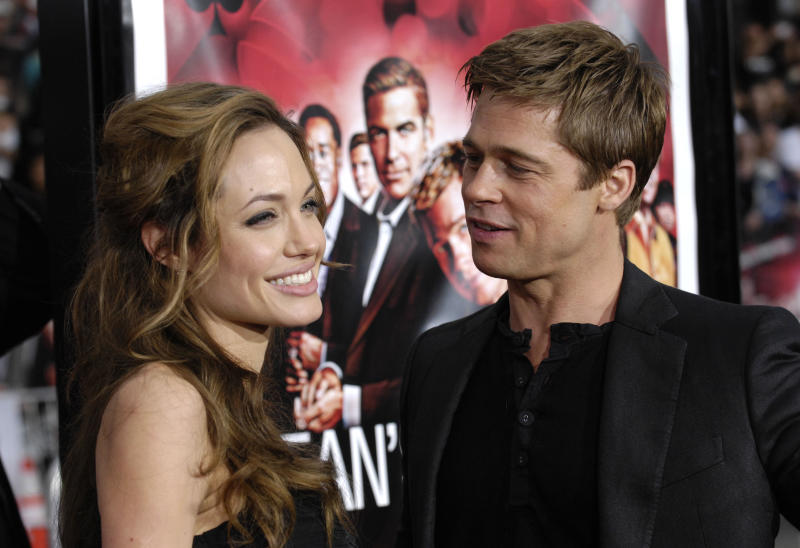 """FILE - In this June 5, 2007 file photo, Angelina Jolie and Brad Pitt arrive at the premiere of """"Ocean's Thirteen"""" in Los Angeles, Calif. Angelina Jolie Pitt has filed for divorce from Brad Pitt, bringing an end to one of the world's most star-studded, tabloid-generating romances. An attorney for Jolie Pitt, Robert Offer, said Tuesday, Sept. 20, 2016, that she has filed for the dissolution of the marriage. (AP Photo/Chris Pizzello, File)"""