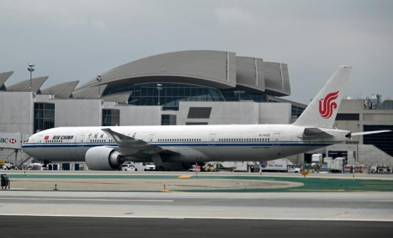 Air China and other Chinese carriers won't be flying to the US anymore (AFP Photo/Daniel SLIM)