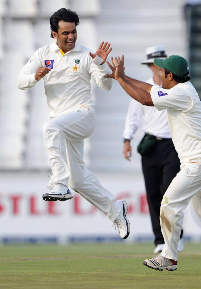 JOHANNESBURG, SOUTH AFRICA - FEBRUARY 01: (SOUTH AFRICA) Mohammad Hafeez of Pakistan celebrates the wicket of Robin Peterson of South Africa during day 1 of the first Test match between South Africa and Pakistan at Bidvest Wanderers Stadium on February 01, 2013 in Johannesburg, South Africa. (Photo by Lee Warren/Gallo Images/Getty Images)