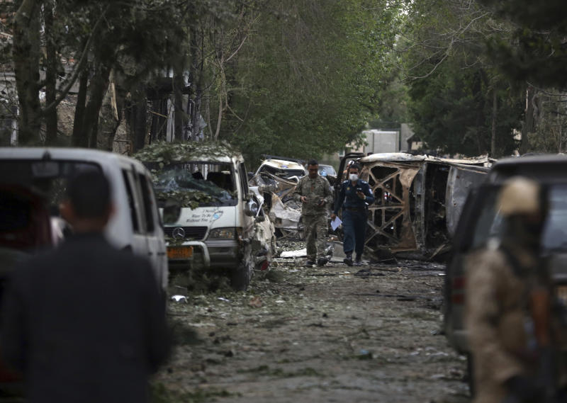 Afghan security forces guard the site of an explosion in Kabul, Afghanistan, Wednesday, May 8, 2019. The Taliban attacked the offices of an international NGO in the Afghan capital, setting off a huge explosion and battling Afghan security forces in an assault that killed at least five people, interior ministry said in a statement. (AP Photo/Rahmat Gul)
