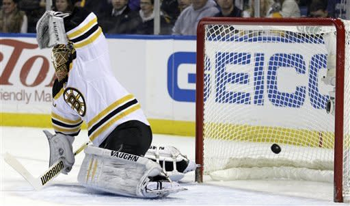Buffalo Sabres' Christian Ehrhoff, not shown, of Germany, scores on Boston Bruins goalie Tuukka Rask, of Finland, during the first period of an NHL hockey game in Buffalo, N.Y., Wednesday, Feb. 8, 2012. (AP Photo/David Duprey)