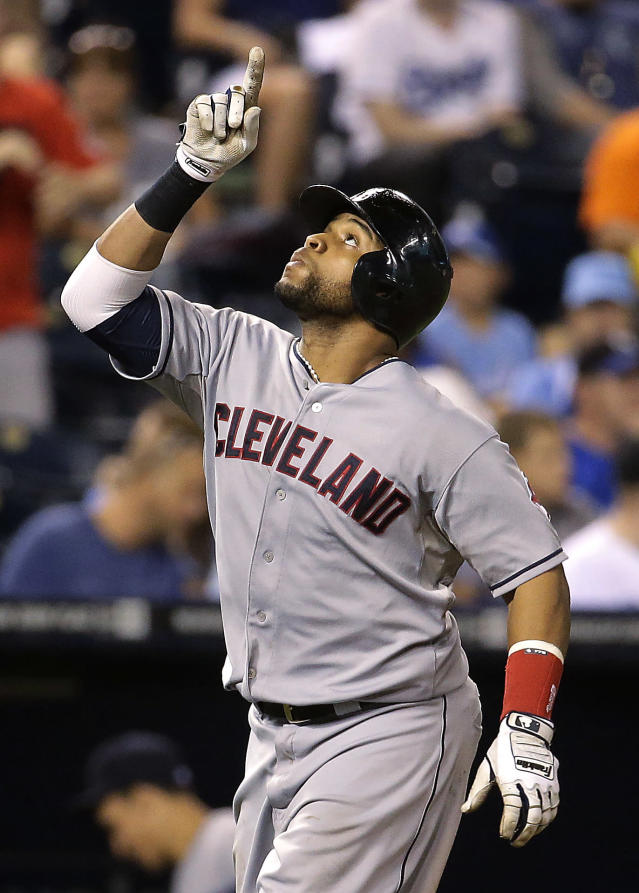 Cleveland Indians' Carlos Santana celebrates as he crosses the plate after hitting a two-run home run during the ninth inning of a baseball game against the Kansas City Royals on Friday, Aug. 29, 2014, in Kansas City, Mo. (AP Photo/Charlie Riedel)