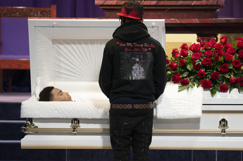 Mourners gather to pay respects to Daunte Wright during his wake at Shiloh Temple International Ministries, Wednesday, April 21, 2021, in Minneapolis. The 20-year-old Wright was killed by then-Brooklyn Center police officer Kim Potter during a traffic stop. (AP Photo/John Minchillo)