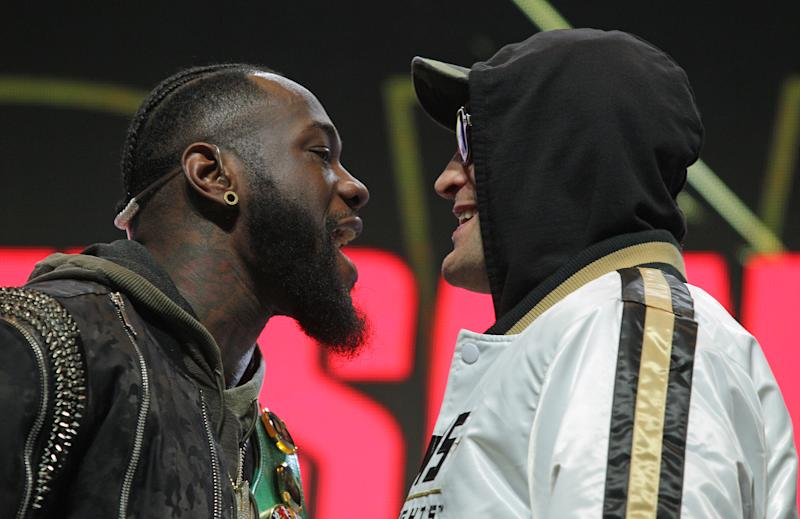 US boxer Deontay Wilder (L) and British boxer Tyson Fury get into an altercation during their press conference February 19, 2020 at the MGM Grand Las Vegas in Las Vegas, Nevada. - The boxers will fight for the World Boxing Council (WBC) Heavyweight Championship Title on February 22, 2020 at the MGM Grand Garden Arena in Las Vegas. (Photo by John Gurzinski / AFP) (Photo by JOHN GURZINSKI/AFP via Getty Images)