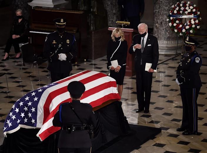 WASHINGTON, DC - SEPTEMBER 25: Democratic presidential nominee Joe Biden and his wife Dr. Jill Biden pay their respects to the late Associate Justice Ruth Bader Ginsburg as her casket lies in state during a memorial service in her honor in the Statuary Hall of the US Capitol, on September 25, 2020 in Washington, DC. Ginsburg, who was appointed by former U.S. President Bill Clinton, served on the high court from 1993, until her death on September 18, 2020. She is the first woman to lie in state at the Capitol.