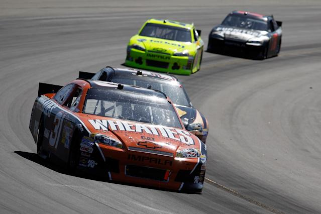 AVONDALE, AZ - MARCH 04: Jeff Burton, driver of the #31 Wheaties Chevrolet, leads a pack of cars during the NASCAR Sprint Cup Series SUBWAY Fresh Fit 500 at Phoenix International Raceway on March 4, 2012 in Avondale, Arizona. (Photo by Todd Warshaw/Getty Images)