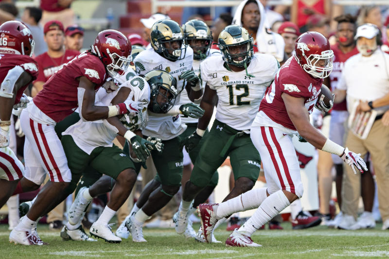 FAYETTEVILLE, AR - SEPTEMBER 14: Cheyenne OGrady #85 of the Arkansas Razorbacks breaks numerous tackles and runs for a touchdown during a game against the Colorado State Rams at Razorback Stadium on September 14, 2019 in Fayetteville, Arkansas. The Razorbacks defeated the Rams 55-34. (Photo by Wesley Hitt/Getty Images)