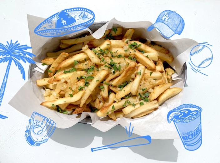 """Sizzling garlic for fries will make your kitchen smell like Dodger Stadium on game night. <span class=""""copyright"""">(Genevieve Ko / Los Angeles Times; Illustrations by Hanna Carter / For The Times)</span>"""