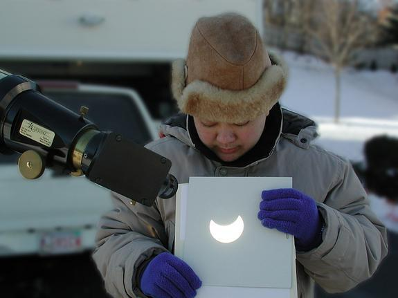 The safest and simplest technique to observe and photograph the eclipse is to use your telescope (or one side of your binoculars) to project a magnified image of the sun's disk onto a shaded white piece of cardboard. This view was taken near B