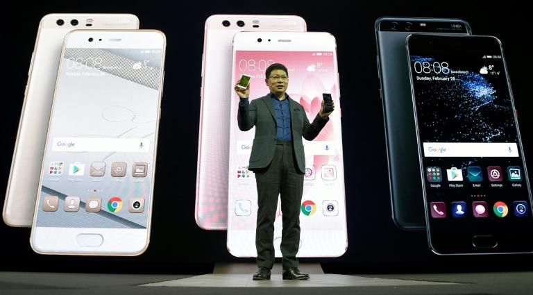 Chinese multinational networking and telecommunications equipment and services company Huawei's CEO Richard Yu presents e Huawei's new P10 phone during a press conference on February 26, 2017 in Barcelona on the eve of the Mobile World Congress
