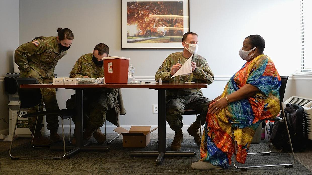 Members of the Missouri National Guard work to administer the Covid-19 vaccine during a vaccination event on February 11, 2021 at the Jeff Vander Lou Senior living facility in St Louis, Missouri. (Michael Thomas/Getty Images)