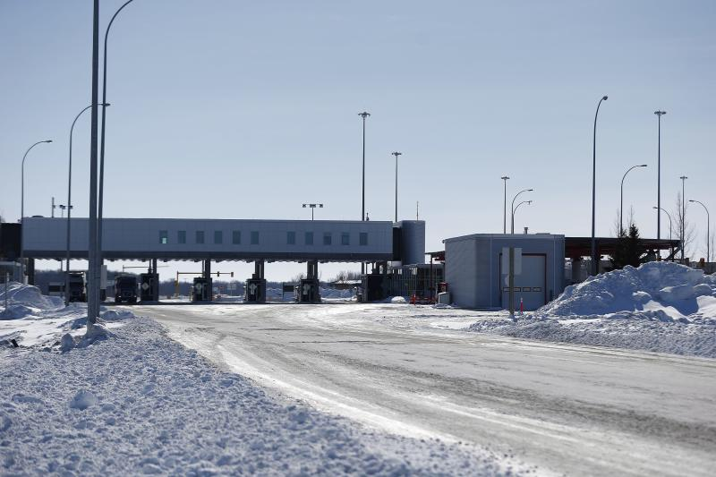 FILE- This Feb. 9, 2017, file photo shows the Canada and United States border crossing near Emerson, Manitoba. Desperate immigrants are flowing across the U.S. border into Canada. America's neighbor to the north is increasingly being seen as a haven for asylum seekers turned away by the U.S., and are willing to chance a walk across the border in dangerous cold to get there. (John Woods/The Canadian Press via AP, File)