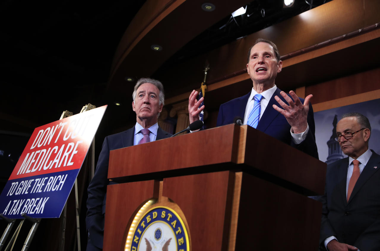 In this Oct. 4, 2017 photo, Rep. Ron Wyden, D-Ore. with Rep. Richard Neal, D-Mass., left, and Senate Minority Leader Chuck Schumer of New York, right, speak during a news conference on Capitol Hill in Washington, Wednesday, Oct. 4, 2017, urging Republicans to abandon cuts to Medicare and Medicaid. More than two dozen Senate Democrats are questioning the legality of the Trump administration's new policy that allows states to require low-income adults to work in order to get Medicaid coverage. In a letter to the administration, the lawmakers say work requirements are out of line with the plain meaning of the Medicaid law, as well as with congressional intent. Expect opponents of the plan to make that argument in a lawsuit. (AP Photo/Manuel Balce Ceneta)
