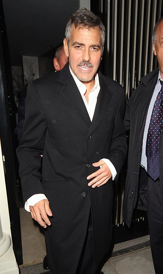 A mustachioed George Clooney threw a star-studded benefit in London Thursday night. The event, organized by the actor and financier Roger Jenkins, raised over 10 million pounds ($14 million) for the victims of Darfur. Dan Weir/ INFDaily.com - December 5, 2008