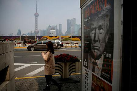 FILE PHOTO: A Chinese magazine poster showing U.S. President Donald Trump is displayed at a newsstand in Shanghai, China, March 21, 2017.   REUTERS/Aly Song/File Photo